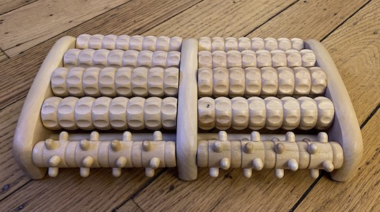 A wooden foot massager with roll pins