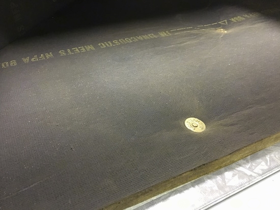 The inside of a fiberglass lined duct
