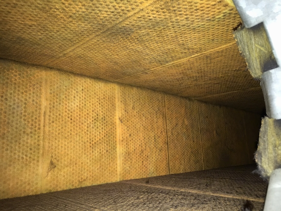A fiberglass lined duct with a yellow cloth-like lining