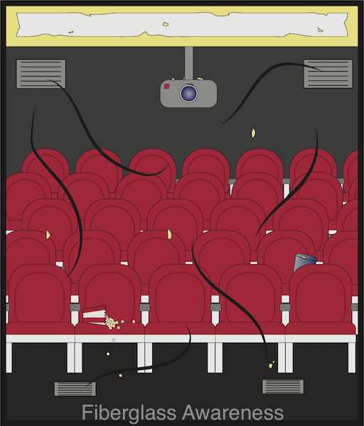 Red movie theater seats with popcorn spilled on the front seat and fiberglass lined ducts above with small pieces of glass floating around getting blown down on the seats.