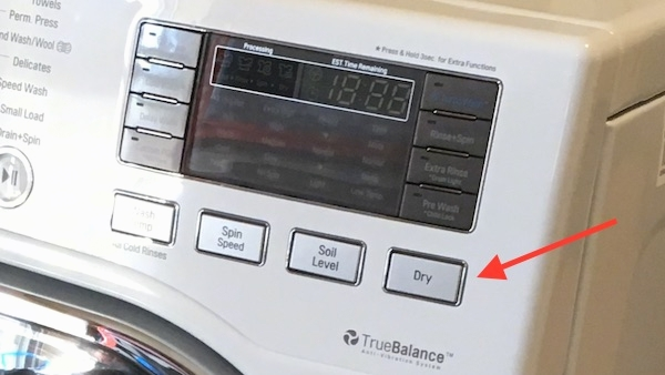 Close up - the buttons on a ventless dryer with a red arrow pointing to the dry button.