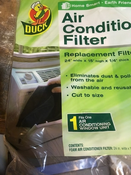 A clear and green plastic Duck brand Air Conditioning Replacement Filter. The package reads  Air Conditioner Filter Replacement Filter 24 wide x 15 high x 1/4 thick, Eliminates dust and pollen from the air, Washable and reusable, Cut to Size. 1 Fits One Air Conditioning Window Unit.